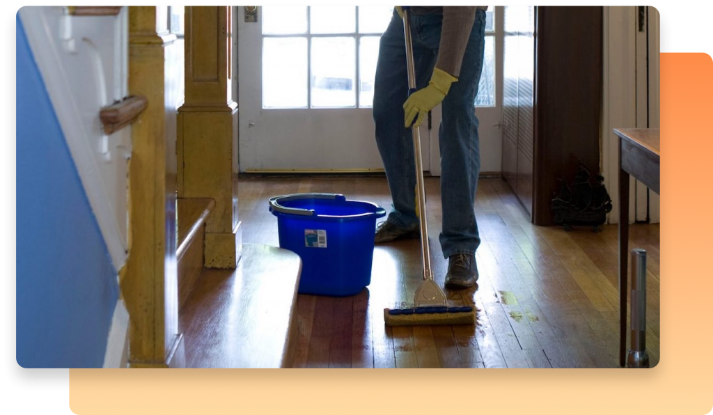 A cleaning service field team member reps for floor of a house