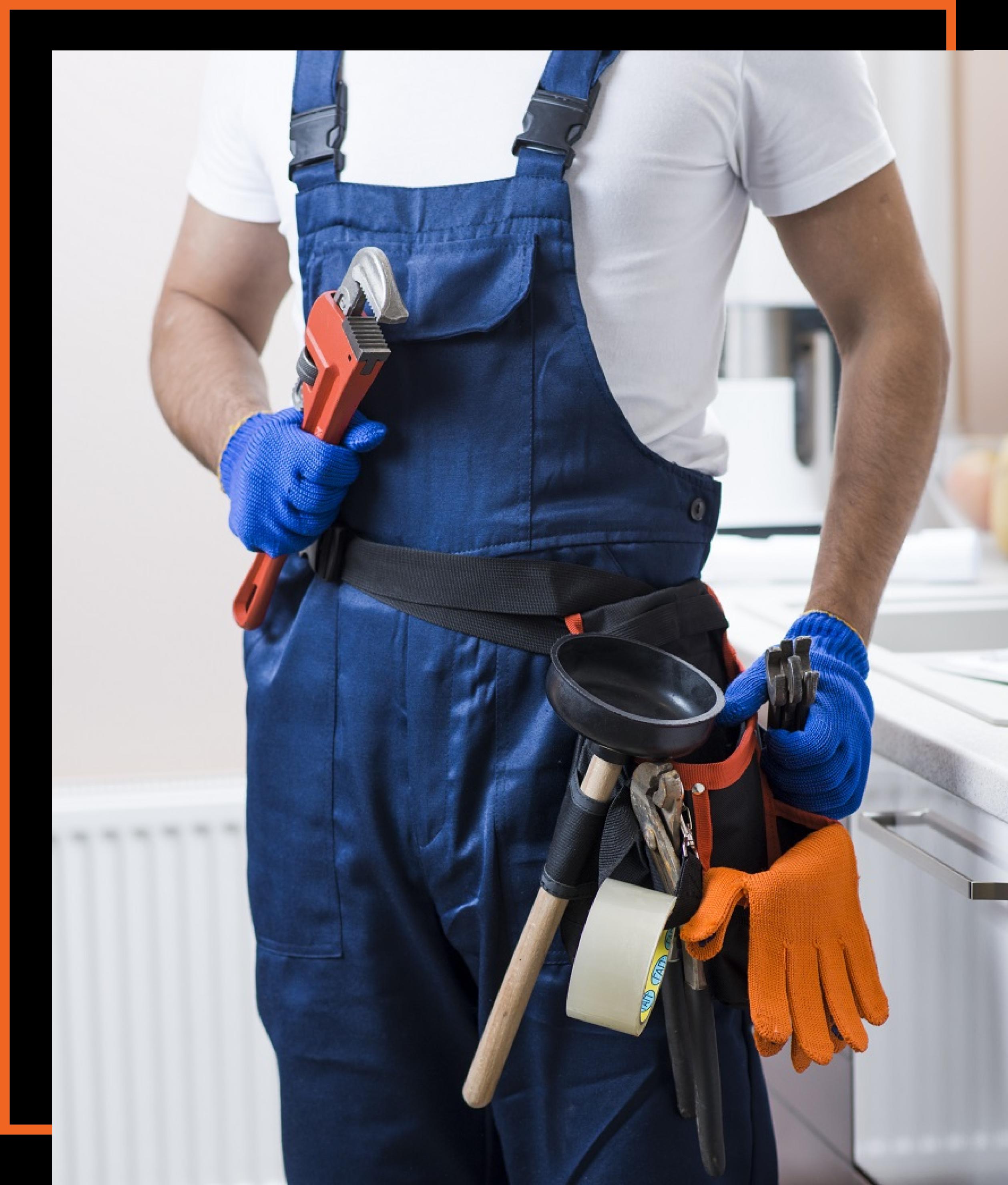 a plumbing tradesman with a decorative orange border
