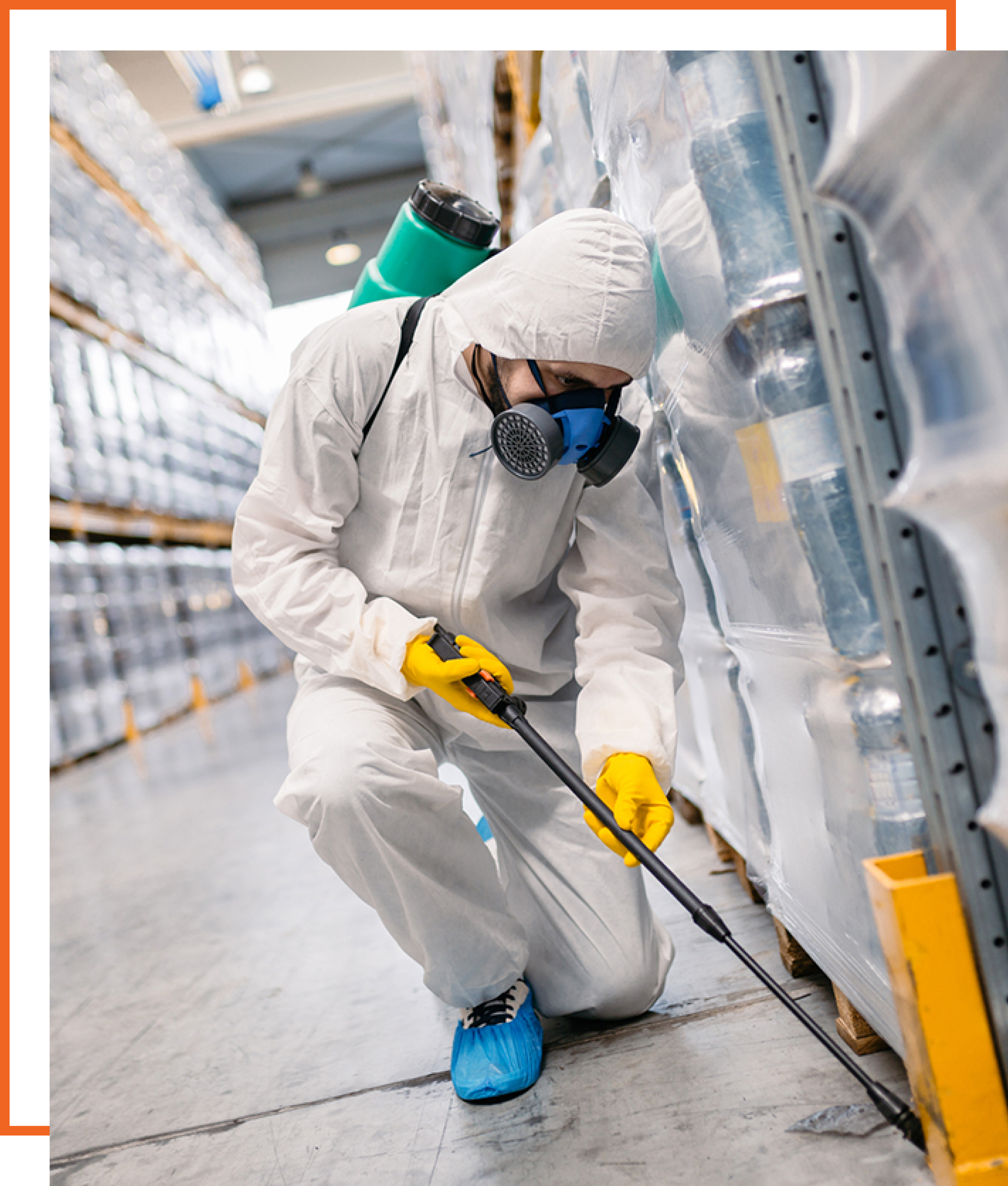 A Pest Control Field Service Engineer working on Site with an orange background