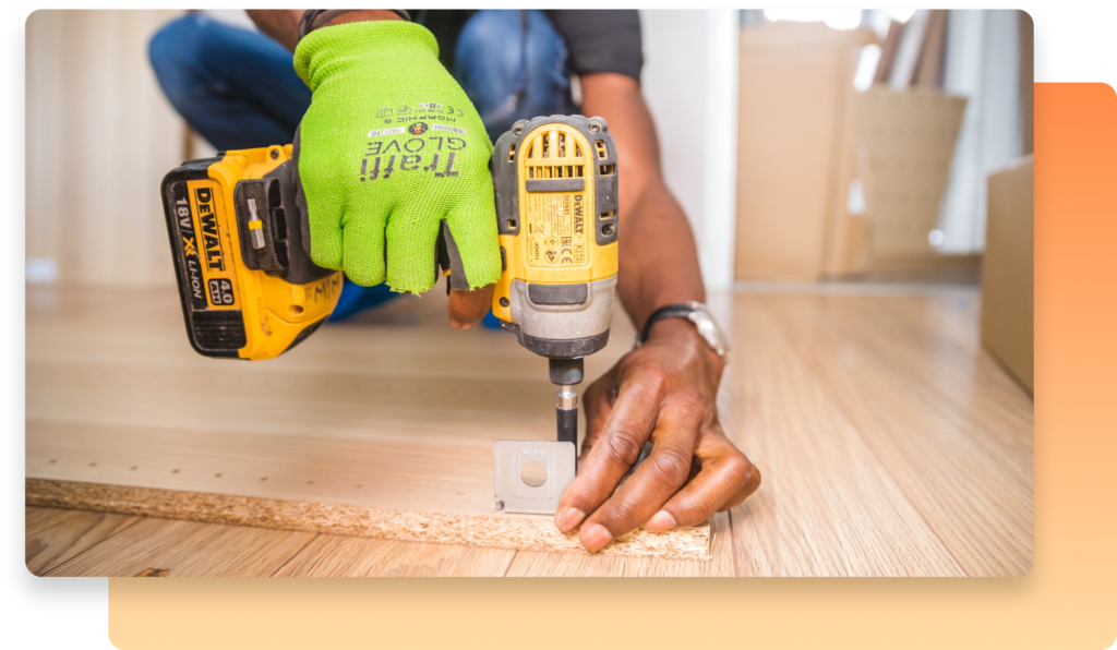 a handyman working on site with an orange background graphic