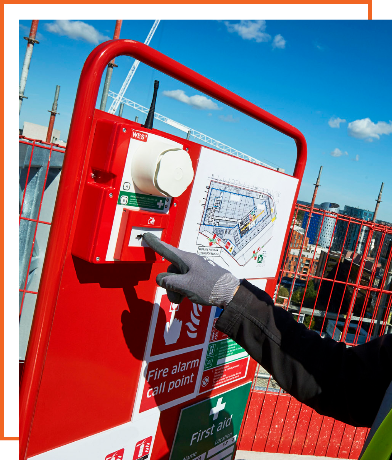 A fire safety engineer testing an on site fire alarm